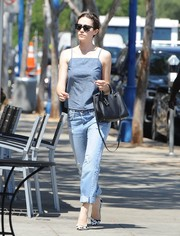 Emmy Rossum teamed her summery top with ripped boyfriend jeans by J Brand.