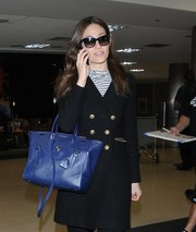 Emmy Rossum made her way through LAX wearing a pair of wayfarer sunglasses.