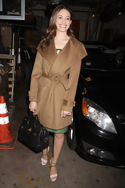 Emmy Rossum maintained her ladylike style with a structured leather bag.