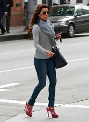 Eva Longoria stepped out in style while in Beverly Hills, pairing  strappy fuchsia sandals with her ultra-casual ensemble.