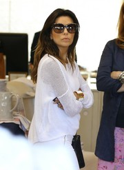 Eva Longoria styled her casual outfit with an Hermes cuff bracelet for a day of shopping.