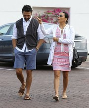 Eva Longoria layered a white utility jacket over a tribal-embroidered dress for a day out in Malibu.