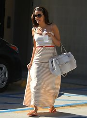 Eva kept it summery and casual while hitting a nail salon when she wore this cream-and-tan strip maxi dress.