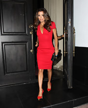 Red Charlotte Olympia pumps with gold platforms finished off Eva Longoria's stylish ensemble.