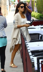 Eva Longoria grabbed lunch in Hollywood wearing a cream-colored shawl-collar cardigan over a mini dress.