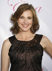 Brenda Strong showed off her medium curls while  attending Eva Logoria's Fragrance launch.