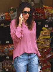Eva Longoria channeled the '70s with these oversized sunnies.