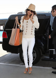 A softly-distressed cream sweater took Eva's white-on-white look from sophisticated to street-chic.