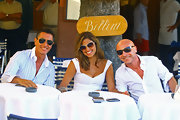 Domenico Dolce looked ready for summer in his cool shield sunglasses while lunching with Stefano and Eva.