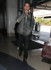 Evan Ross's faded denim jacket is perfect for staying comfortable during long haul flights.