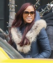 Eve was looking chic in a fur-collar jacket and butterfly sunnies as she caught a cab in New York.
