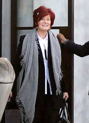 The Osbourne family was spotted at Maxfields with Sharon Osbourne wearing a checked scarf on top of her pantsuit.