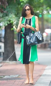 Famke Janssen chose a flowing green and black color-blocked dress for her casual look while our in NYC.