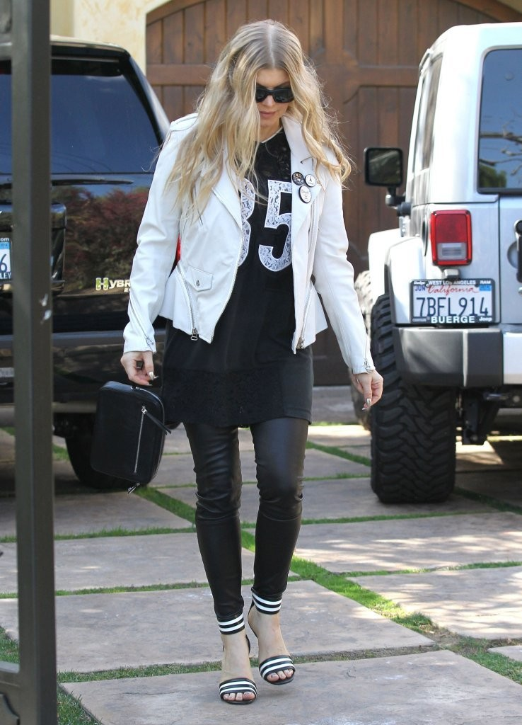 Singer Fergie having a busy Super Bowl Sunday in Los Angeles, California on February 2, 2014. First Fergie went to church, stopped by a relatives house and then took her son Axl to her mother's house to watch the Super Bowl.
