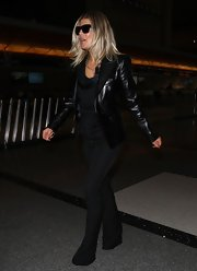 Fergie was downtown cool in all black, finished off by a tough chic leather jacket.