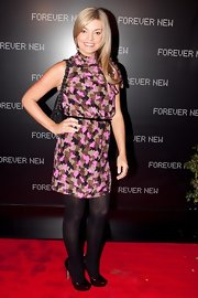 Natalie Hunter paired her printed dress and pumps with a printed dress.