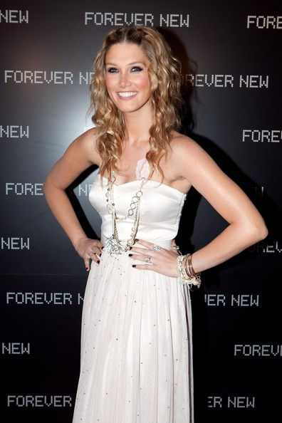 Delta topped her white dress off with a layered pearl necklace.