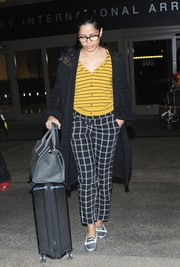 Freida Pinto clashed her stripes with grid-print pants by Vince Camuto.