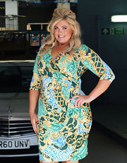 Gemma Collins posed during a visit to the ITV Studios wearing a printed wrap dress from her very own clothing line.