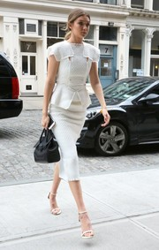 Stuart Weitzman strappy nude sandals completed Gigi Hadid's modern street style outfit.