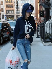Gigi Hadid tried to keep a low profile with a New York Rangers cap teamed with a hoodie while out and about.