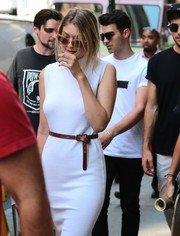 Gigi Hadid jazzed up her white dress with a brown leather belt for a day out in New York City.