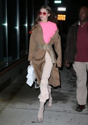 Gigi Hadid stepped out in New York City wearing a tan Ports 1961 coat, which worked stylishly with her pink sweater.
