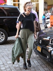 Gigi Hadid paired her top with cool and comfy olive-green harem pants by Reebok.
