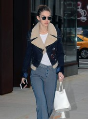 Gigi Hadid headed out in New York City sporting a pair of round shades by Krewe.