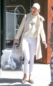 Underneath her coat, Gigi Hadid wore white skinny jeans and a boxy top.