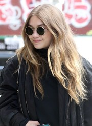 Gigi Hadid amped up the boho feel with a pair of round sunglasses by Oliver Peoples The Row.