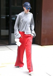 Gigi Hadid completed her slouchy look with red wide-leg track pants by Tommy Hilfiger.