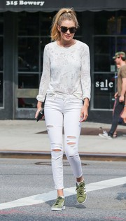 Gigi Hadid dressed down in ripped jeans by Paige for a stroll in New York City.