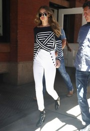 Gigi Hadid made her way to her photo shoot wearing a black-and-white striped boatneck sweater.