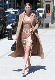 Gigi Hadid looked sharp on the streets of New York City in a beige Topshop coat layered over a matching silk dress.