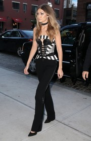 Gigi Hadid made her way to 'The Tonight Show' looking sexy in a black-and-white striped corset top by Rubin Singer.