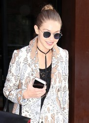 Gigi Hadid accessorized with a black leather bolo choker by Erth for a day out in New York City.