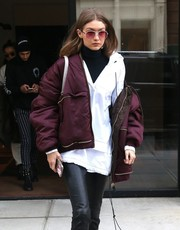 Gigi Hadid was in the mood for purple, matching her aviators to her jacket!