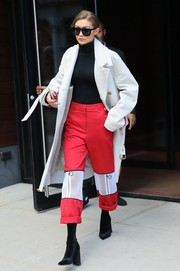 Gigi Hadid looked sporty in her red and white wide-leg pants while out in New York City.