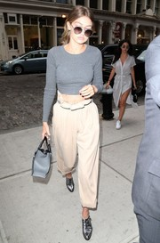 Gigi Hadid teamed her top with cute paperbag capris.