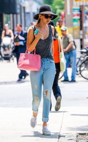Gigi Hadid kept it super relaxed in a distressed gray tank top while out and about in New York City.