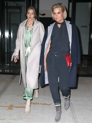 Gigi Hadid enjoyed a night out in New York City wearing a gray wool coat over striped pajamas.