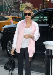 Hailey Baldwin kept her eyes hidden behind a pair of rectangular shades as she headed to Gidi Hadid's apartment.