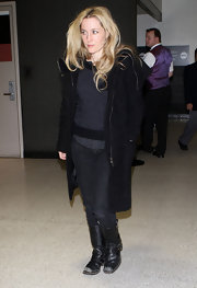 Gillian Anderson made her way through LAX in a pair of scuffed black leather motorcycle boots.