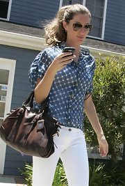 """Gisele opts for the classic aviator shape with the gold """"Hagen"""" shades."""