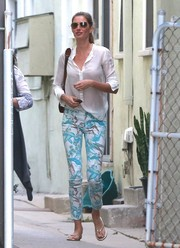 Gisele Bundchen styled her top with a pair of print pants that showed off her shapely legs.