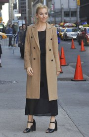 Sienna Miller arrived for her 'Stephen Colbert' appearance wearing a classic double-breasted coat by Rag & Bone.
