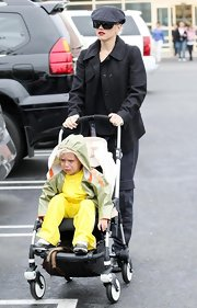 Gwen Stefani wore a plaid newsboy cap while making a visit to Babies R Us.