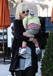 Gwen rocked a retro pair of white cateye shades while toting her trendy tot in Malibu.