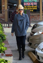 Gwen Stefani completed her edgy look with a pair of black knee-high boots.